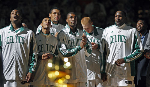 Celtics players looked on as the 17th championship banner was raised to the rafters.