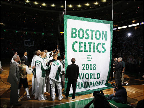 Celtics players and team personnel gathered to raise the Celtics' 17th NBA championship banner during ceremonies prior to the season opener against the Cleveland Caveliers.