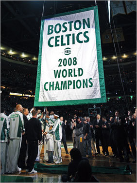 Celtics players raised the franchise's 17th championship banner prior to the season opener.