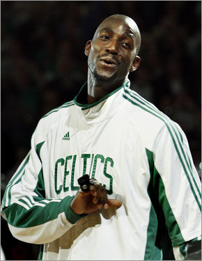Celtics forward Kevin Garnett reacted after receiving his championship ring during celebrations.