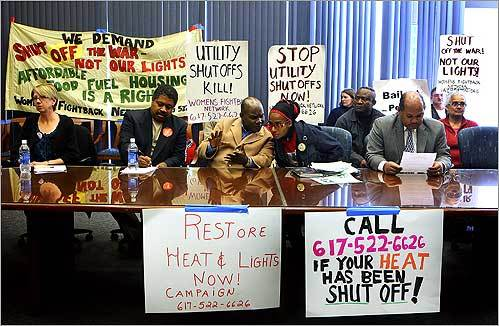 At a City Hall press conference on Oct. 27, activists called out for an emergency measure to restore heat and light to families who are unable to pay their bills. From left at the front of the table are Nan Genger, of Women's Fightback Network; Jean-Claude Sanon, candidate for City Councilor at-Large in 2009; Josue Renaud, president of the New England Human Rights Organization; Miya X, of Women's Fightback Network; and City Councilor Charles Yancey.