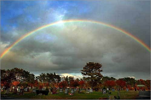 A full rainbow appeared late in the afternoon over Central Cemetery on North Street in Randolph after a day of heavy rain and wind on Oct. 28.