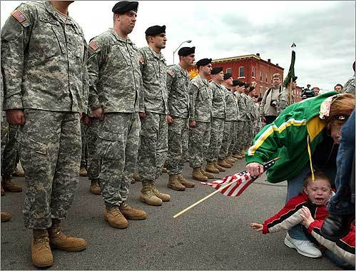 During a deployment ceremony of the 772nd Military Police Company, Massachusetts National Guard, on Taunton Green, a tearful Morgan Riddick, 3, of Woonsocket, R.I., was pulled away from his father, Thomas (left), on Oct. 29. Thomas Riddick is among 180 soldiers who left after the ceremony for a year of deployment in Iraq. The unit will be responsible for training, mentoring, and coaching Iraqi Police.