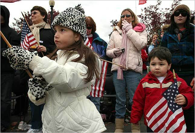 Young girl and boy hold flags