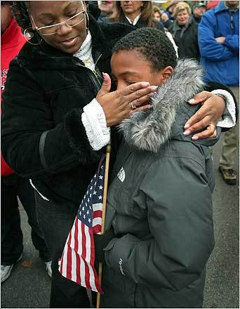 a boy cries as he watches his father leave for Iraq