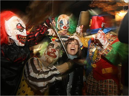 Vanessa Beer of Boston (middle) is 'attacked' by a posse of insane clowns from Seymour, Conn.