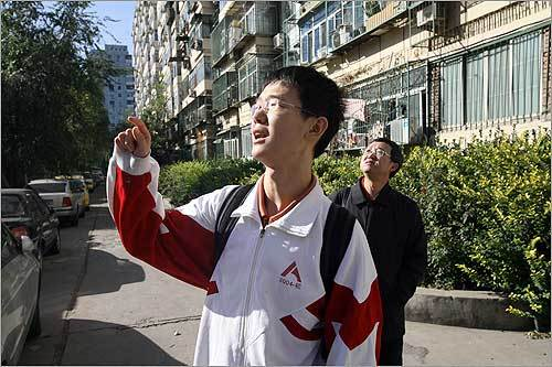 "Tiger walked with his father, Li Chengyi, in his school's neighborhood in Beijing. He hopes that one day he will attend Harvard, saying: ""I want to turn the impossible into the possible.'"