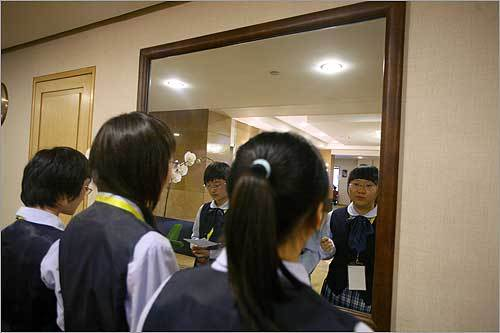 At left, students Zeng Minyu (left), Cai Shujun (center) and Jiang Yizhi practiced their presentation for the Shing Tung Yau High School Mathematics Awards in Beijing, which was attended by Harvard's admissions dean. Many officials from premier American universities are trying to recruit students from China who might otherwise dismiss the schools as unattainable.