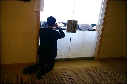 Parents and teachers were banned from the conference room where the competition took place. One man took pictures of the students through a glass door in the plush 5-star hotel.