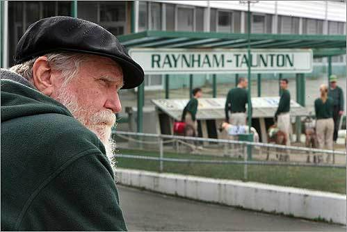 A day after Massachusetts voters voted against greyhound racing, Calvin Titus, of Sandwich , watched the dogs at the start of the 1st race at the Raynham-Taunton dog track on Nov. 5.