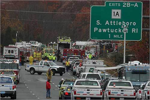 Rescue workers and cleanup crews gathered on I-95 southbound in Attleboro afer a tanker truck carrying jet fuel rolled over onto a passenger vehicle. Three people were injured.