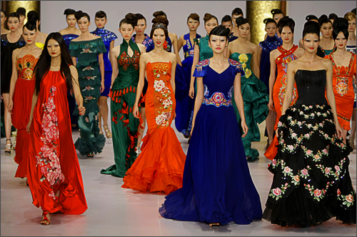 Models present creations for NE TIGER 2009 Haute Couture Show at China Fashion Week in Beijing, November 5, 2008.