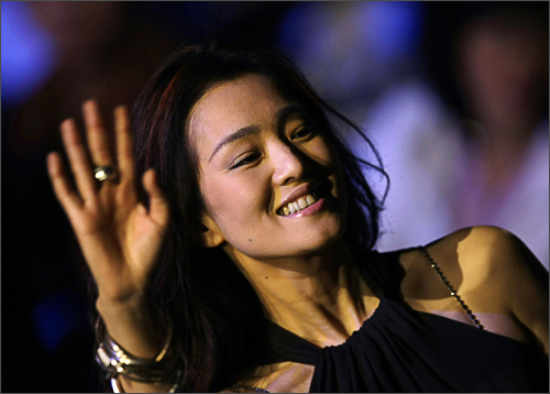 Chinese movie star Gong Li waves as she attends Aimer lingerie trends release Spring/Summer 2009 at China Fashion Week in Beijing, November 4, 2008. See more photography at Boston.com/photos
