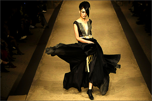A model presents a creation by designer Ma Yanli during the Maryma series high fashion show at China Fashion Week in Beijing, November 7, 2008.