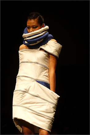 A Model shows off the designs of Chinese students at the Raffles Beijing Student graduation fashion show during China Fashion Week in Beijing Thursday, Nov. 6, 2008.