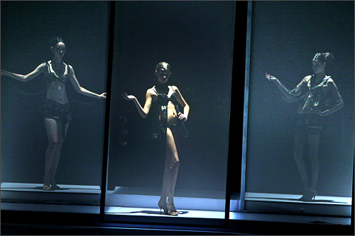 Chinese models behind screens show off works of a designer taking part in the Ordifen Innovative Design for China Undergarment Elements 2008 show held to start the China Fashion week in Beijing Wednesday, Nov. 5, 2008.