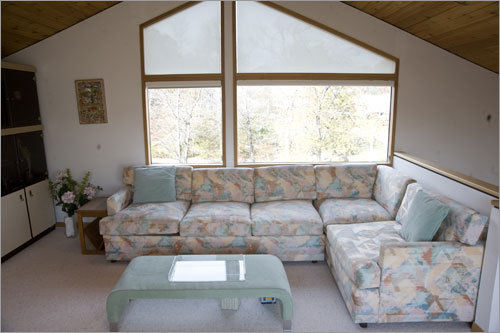 The home also has an upstairs loft with huge windows.