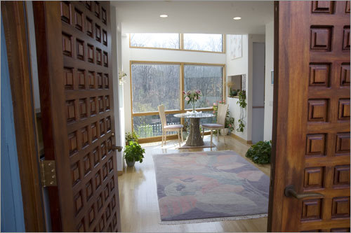 A view into the home through the mahogany front doors, which have a waffle pattern.