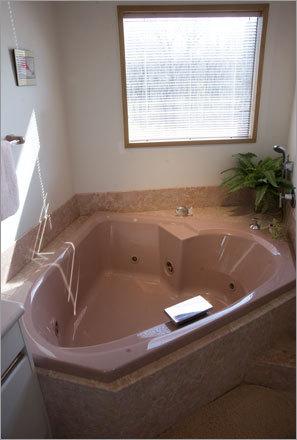 The master bathroom has a jacuzzi tub.