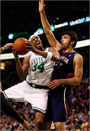 Boston Celtics small forward Paul Pierce (34) was fouled on the way to the basket by Atlanta Hawks center Zaza Pachulia in the 2d quarter on Nov. 12.
