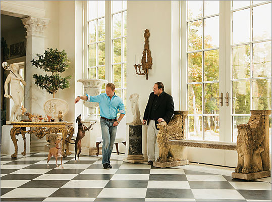 "Life at the villa The ""loggia"" in the home of Alexander Westerhoff (left) and Tom Lang is dotted with early 18th-century European sculptures and storied antiques."
