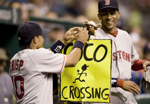 Coco Crisp (left) attached a Mariner Moose doll to a sign left by the Tampa Bay Devil Rays mascot in front of Boston's dugout. Crisp had a near collision with the Seattle Mariners mascot earlier in the month.