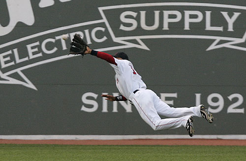 Coco went horizontal to make yet another spectacular diving catch, this time robbing Oakland's Mark Ellis of a hit at Fenway Park.