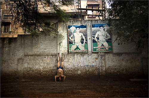 A Pakistani wrestler exercises as part of his training at the Champion Manila Wrestling Club in the Old City of Lahore, Pakistan, Sunday, Nov. 16, 2008.