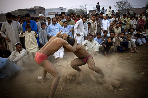Pakistani wrestlers fight during a local competition in Lahore, Pakistan, Saturday, Nov. 15, 2008.