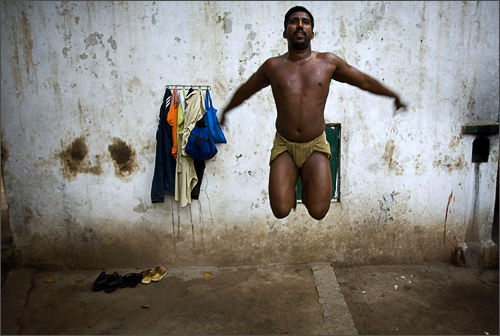 A Pakistani wrestler exercises at the Champion Manila Wrestling Club in the Old City of Lahore, Pakistan, Saturday, Nov. 15, 2008.