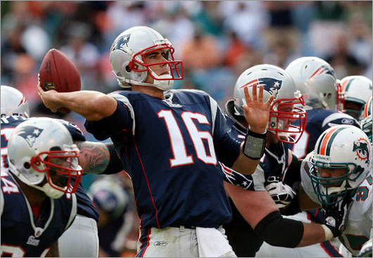 Quarterback Matt Cassel of the Patriots throws a touchdown pass to wide receiver Randy Moss in the third quarter against Miami at Dolphin Stadium.