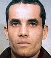 MILLENNIUM PLOT Border guards arrested Ahmed Ressam as he drove a car packed with explosives off a ferry from Canada in December 1999.