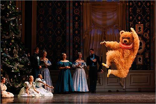 Paul Craig danced the part of the Bear during the Party scene in a dress rehearsal of the Boston Ballet's 'Nutcracker' on Nov. 26. at the Opera House in Boston. The children were from the Boston Ballet School.