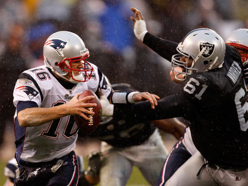Conquering adversity Cassel, in an inspiring performance just six days after his father's death , passed for 218 yards and threw two of his career-best four touchdown passes to Randy Moss, who reveled in the Raider Nation's disgust during the Patriots' 49-26 victory over Oakland in Week 15.