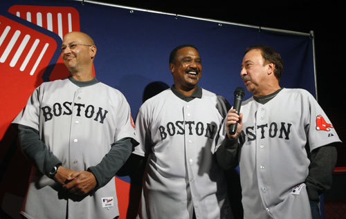 At an event held at Game On restaurant in Boston, the Red Sox unveiled new club logos, uniforms and hats that will debut on the field at the start of the '09 season. The changes include new road uniforms, and also a new alternate road jersey, and a new hat with a 'Hanging Sox' logo to go with the alternate road jersey ( Read the story and discussion here ). Here manager Terry Francona (left) and former players Jim Rice and Jerry Remy show off the new primary road jersey.