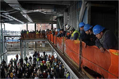 High winds canceled the topping off of the new building at One Marina Park on Boston's Fan Pier on Dec. 10. Instead, there was a short ceremony attended by Mayor Thomas Menino and Joseph Fallon, president and CEO of the Fallon Company.