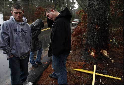 Michael Clark (left) and Bryan Medas visited the crash scene on Purchase Street in Middleborough where two Middleborough High School seniors were killed in a car on Dec. 11. Michael Clark said he had spent the evening before with one of the victims playing pool.