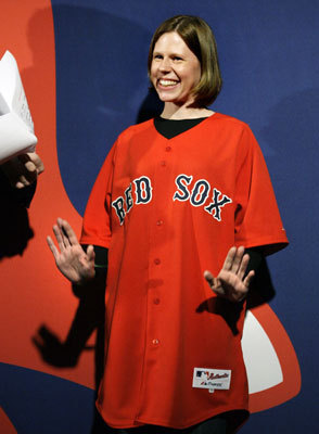 Red Sox fan Lynn Hendrickson of Nashua, N.H., reacts as she is introduced while modeling the new alternate home uniform jersey in Boston on Thursday.