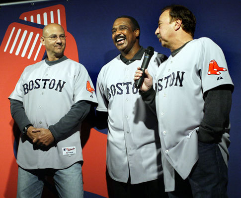 Red Sox Terry Francona (left) and former player Jim Rice (center) listen to former player and current TV announcer Jerry Remy speak about the new primary road uniform jersey that they all were modeling in Boston on Thursday.