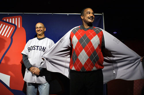 Red Sox manager Terry Francona (left) smiles as former Red Sox player Jim Rice jokes around as they model the new primary road uniform jersey.