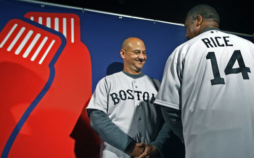 Red Sox manager Terry Francona (left) and former player Jim Rice (right) show off the front and back respectively of the new primary road jersey. Part of the slightly tweaked logo is seen at left.