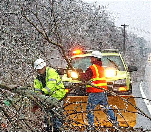 Mass Highway work crews cleared downed limbs on Route 20 in Auburn.