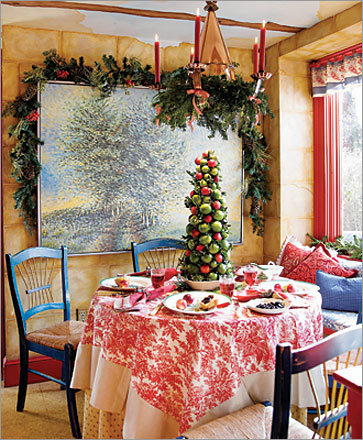 "The colors of Dickerson's kitchen and living room, decorated in the French Country style, are shades of red, coral, and lots of different greens. ""They are very conducive to Christmas colors, and I did that very intentionally,"" says Dickerson."
