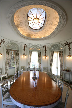 An oval-shaped dining room features an inlaid floor of green Connemara marble from Ireland and a skylight is made of translucent stone.