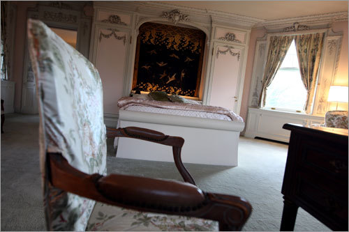 The mansion's master bedroom is shown here.