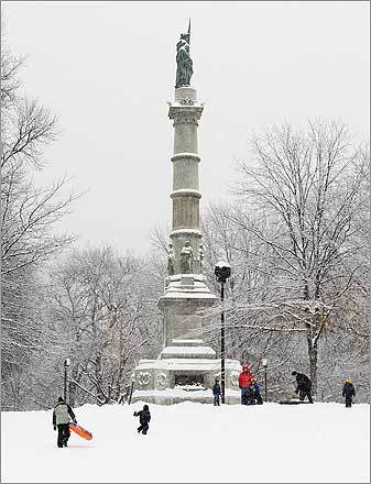 Sledders made their way up and down a hill in Boston Common on Sunday.