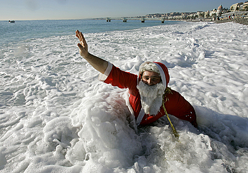 A man dressed as Santa prepared for the 64th pre-Christmas swim in Nice, southern France, on Dec. 21.