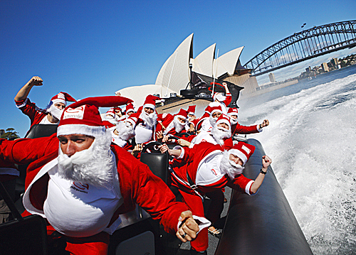Fourteen thrill-seeking Santa Clauses got into the spirit by riding an Adrenalin high-speed boat around Sydney Harbor in Australia on Dec. 14. In Sydney, where Christmas falls during Australia's summer, people traditionally celebrate the holidays on the beach or by the harbor.