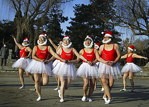 Chinese winter swimmers dressed in Santa costumes danced before taking a dip in Shenyang, located in northeast China's Liaoning province, on Dec. 20.
