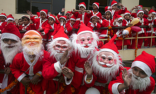 Students dressed as Santa Claus performed during a cultural program at a school in the northern Indian city of Chandigarh on Dec. 20.